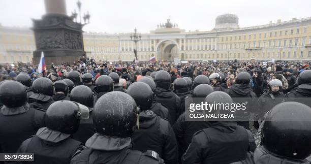 TOPSHOT Opposition supporters participate in an anticorruption rally in central Saint Petersburg on March 26 2017 Thousands of Russians demonstrated...