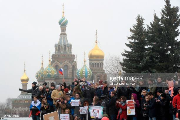 TOPSHOT Opposition supporters rally against corruption in central Saint Petersburg on March 26 2017 Thousands of Russians demonstrated across the...