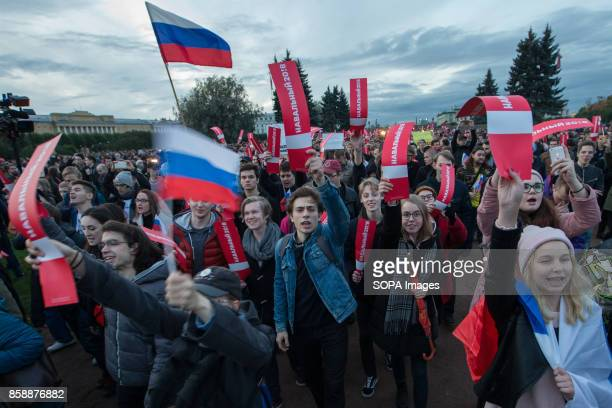 Opposition supporters seen holding Russian flags while participating in an unauthorized rally The President of Russia Vladimir Putin celebrated his...