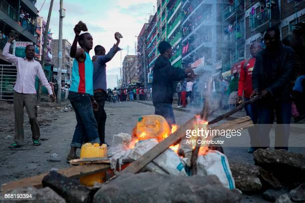 Opposition supporters set up a roadblock after the announcement of the reelection's result by Kenya's Independent Electoral and Boundaries Commission...