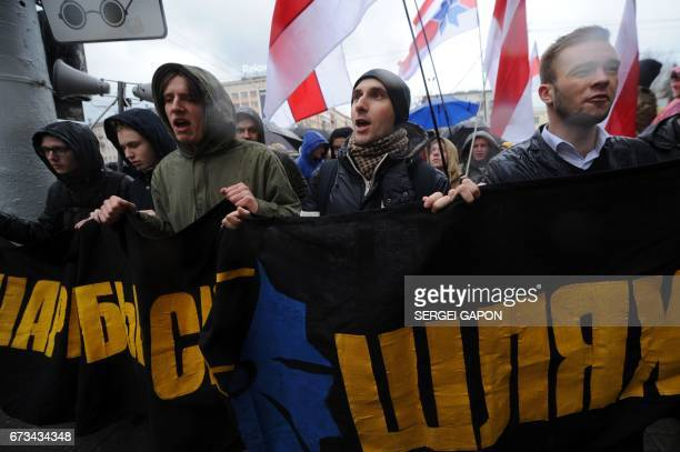 Opposition supporters take part in a rally in Minsk on April 26 to commemorate the victims of the Chernobyl nuclear disaster on the 31st anniversary...