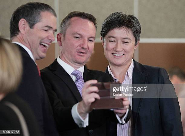Opposition treasurer Chris Bowen takes a selfie with Shadow Minister for Trade and Investment Senator Penny Wong and Shadow Minister for Defence...