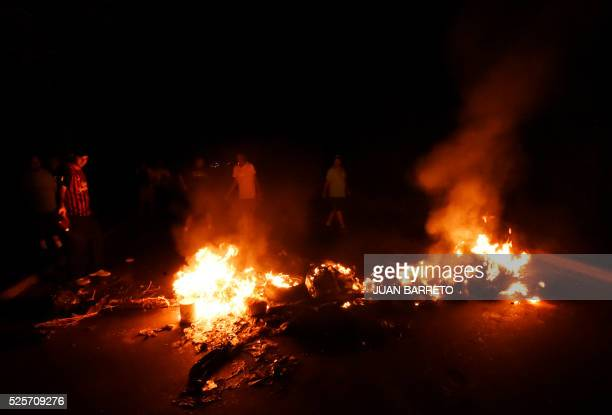 Oppositors of Venezuela's President Nicolas Maduro set up fire barricades during demonstrations in Maracaibo city on April 28 2016 The president of...