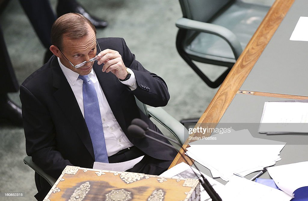 Oppostion leader <a gi-track='captionPersonalityLinkClicked' href=/galleries/search?phrase=Tony+Abbott&family=editorial&specificpeople=220956 ng-click='$event.stopPropagation()'>Tony Abbott</a> during House of Representatives question time at Parliament House on February 7, 2013 in Canberra, Australia. Parliament resumes for the first sitting of 2013 this week, just days after Prime Minister Gillard, announced a federal election date of September 14, 2013.