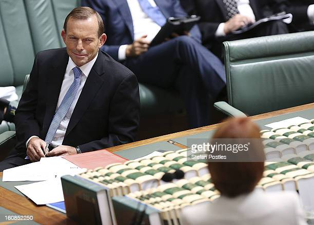 Oppostion leader Tony Abbott looks at Prime Minister Julia Gillard during House of Representatives question time at Parliament House on February 7...