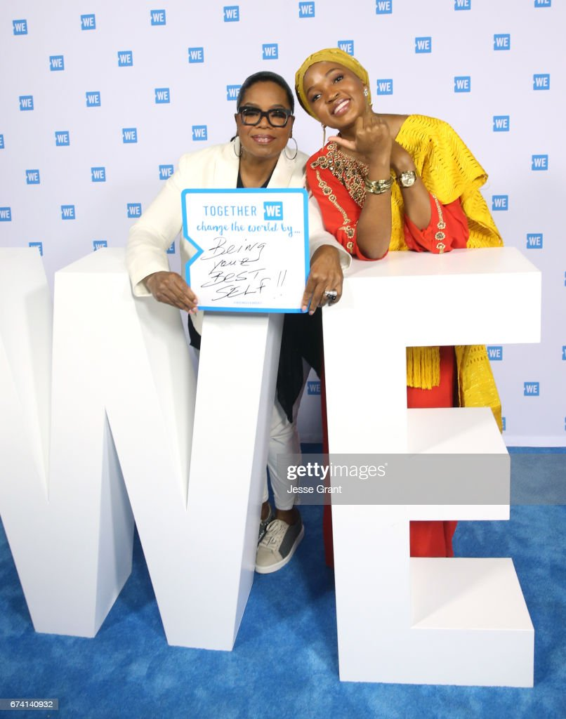 Oprah (L) and motivational speaker Mpumi Nobiva pose for a photo at WE Day California to celebrate young people changing the world at The Forum on April 27, 2017 in Inglewood, California.