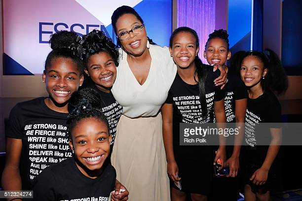 Oprah poses with members of the Amazing Grace Conservatory during the 2016 ESSENCE Black Women In Hollywood awards luncheon at the Beverly Wilshire...