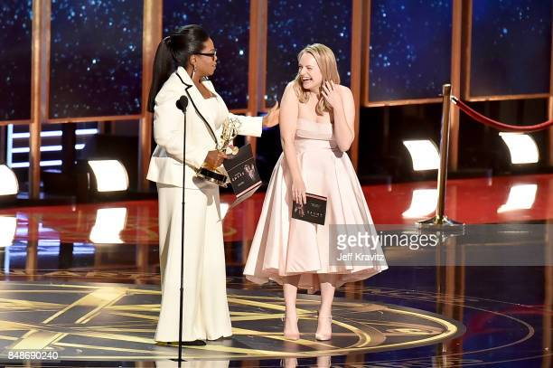 Oprah presents actor Elisabeth Moss with the Outstanding Lead Actress in a Drama Series award for 'The Handmaid's Tale' onstage during the 69th...