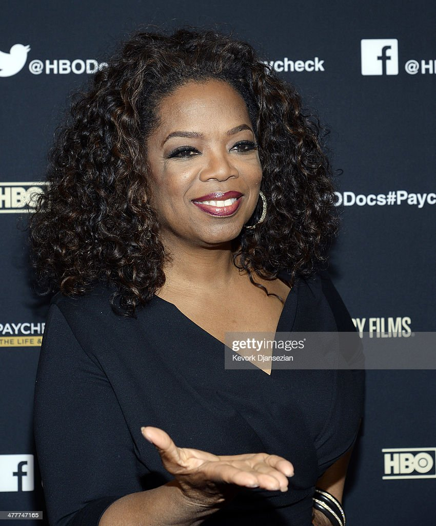 Oprah Winfrey (L) and executive producer Maria Shriver attend the premiere of HBO Documentary Films' 'Paycheck To Paycheck' at Linwood Dunn Theater at the Pickford Center for Motion Study on March 10, 2014 in Hollywood, California.
