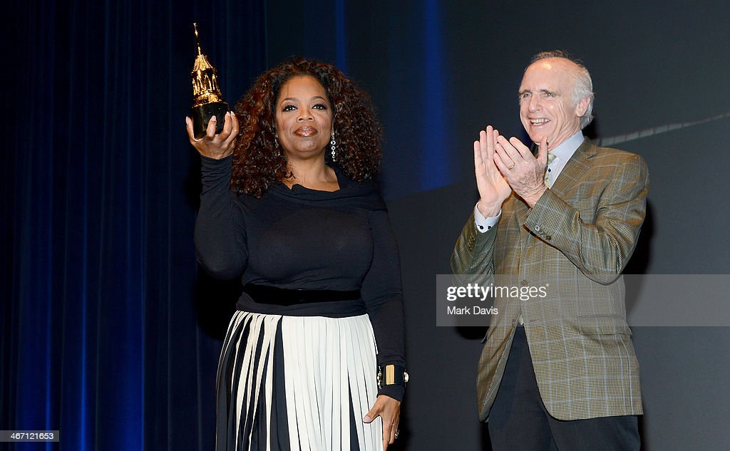 <a gi-track='captionPersonalityLinkClicked' href=/galleries/search?phrase=Oprah+Winfrey&family=editorial&specificpeople=171750 ng-click='$event.stopPropagation()'>Oprah Winfrey</a> and Jeff Barbakow speak at the 29th Santa Barbara International Film Festival Montecito Award to <a gi-track='captionPersonalityLinkClicked' href=/galleries/search?phrase=Oprah+Winfrey&family=editorial&specificpeople=171750 ng-click='$event.stopPropagation()'>Oprah Winfrey</a> at the Arlington Theatre on February 5, 2014 in Santa Barbara, California.