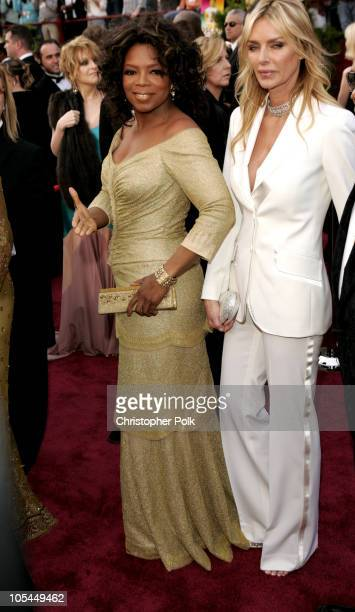 Oprah Winfrey and Kimberly Hefner during The 77th Annual Academy Awards Arrivals at Kodak Theatre in Los Angeles California United States