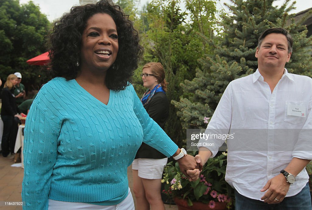 Oprah Winfrey and Ted Sarandos (R), chief content officer at Netflix, chat at the Allen & Company Sun Valley Conference on July 7, 2011 in Sun Valley, Idaho. The conference has been hosted annually by the investment firm Allen & Company each July since 1983. The conference is typically attended by many of the world's most powerful media executives.