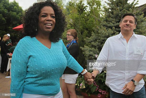 Oprah Winfrey and Ted Sarandos chief content officer at Netflix chat at the Allen Company Sun Valley Conference on July 7 2011 in Sun Valley Idaho...
