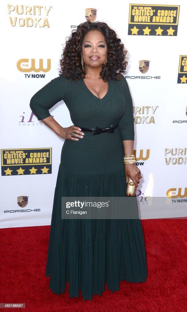 Oprah Winfrey arrives at the 19th Annual Critics' Choice Movie Awards at Barker Hangar on January 16, 2014 in Santa Monica, California.