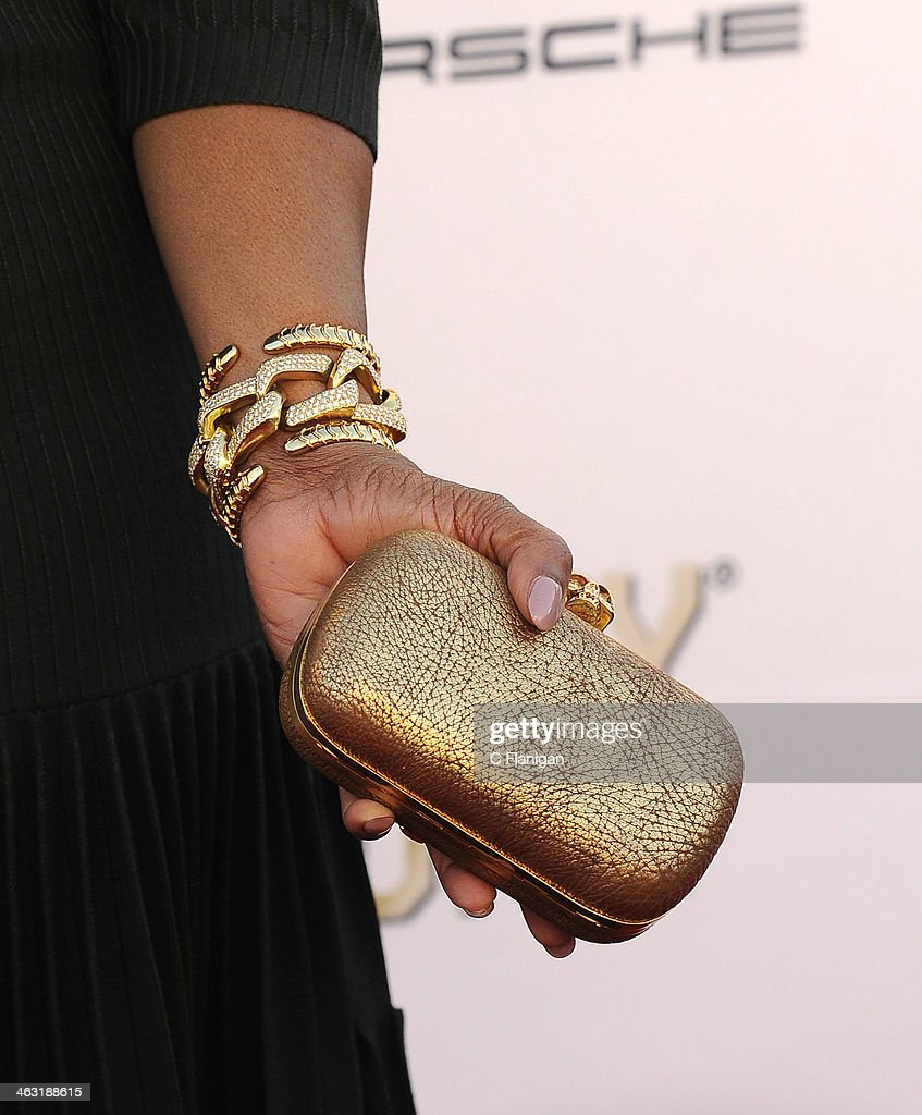 Oprah Winfrey (Purse and Bracelet Detail) arrives at the 19th Annual Critics' Choice Movie Awards at Barker Hangar on January 16, 2014 in Santa Monica, California.