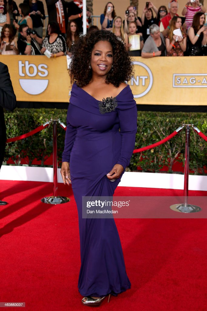 <a gi-track='captionPersonalityLinkClicked' href=/galleries/search?phrase=Oprah+Winfrey&family=editorial&specificpeople=171750 ng-click='$event.stopPropagation()'>Oprah Winfrey</a> arrives at the 20th Annual Screen Actors Guild Awards at the Shrine Auditorium on January 18, 2014 in Los Angeles, California.