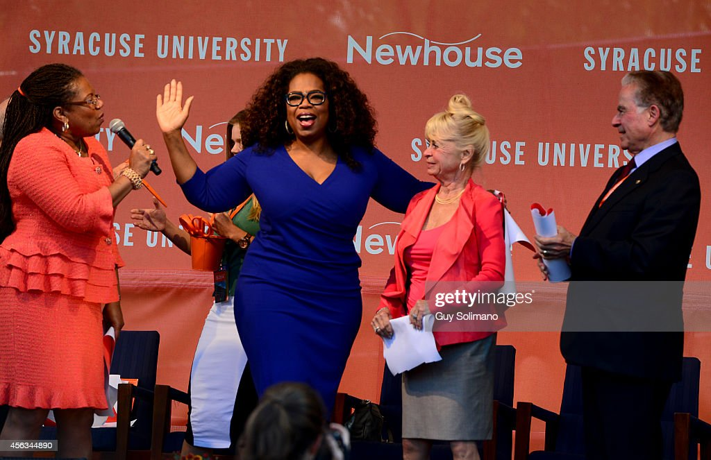 Oprah Winfrey center puts her arm around Kari Clark widow of Dick Clark during the Dick Clark Studios dedication ceremony at the S I Newhouse School...