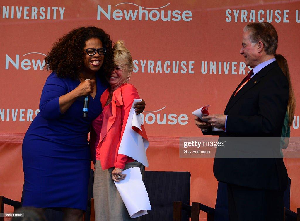 Oprah Winfrey embraces Kari Clark widow of Dick Clark during the Dick Clark Studios dedication ceremony at the S I Newhouse School of Public...
