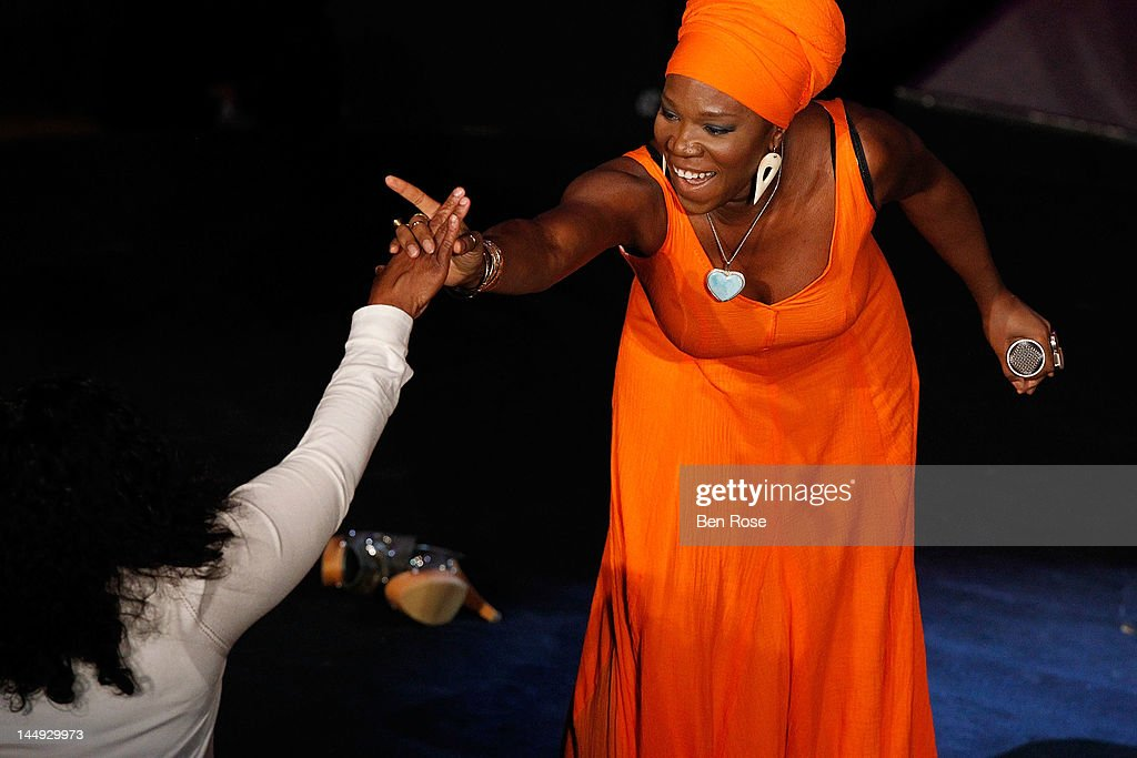 Oprah Winfrey (L) gives a 'high five' to singer India Arie following her performance at The Andrew Young Foundation's celebration of the 80th birthday of Andrew Young at The Hyatt Regency Atlanta on May 20, 2012 in Atlanta, Georgia.