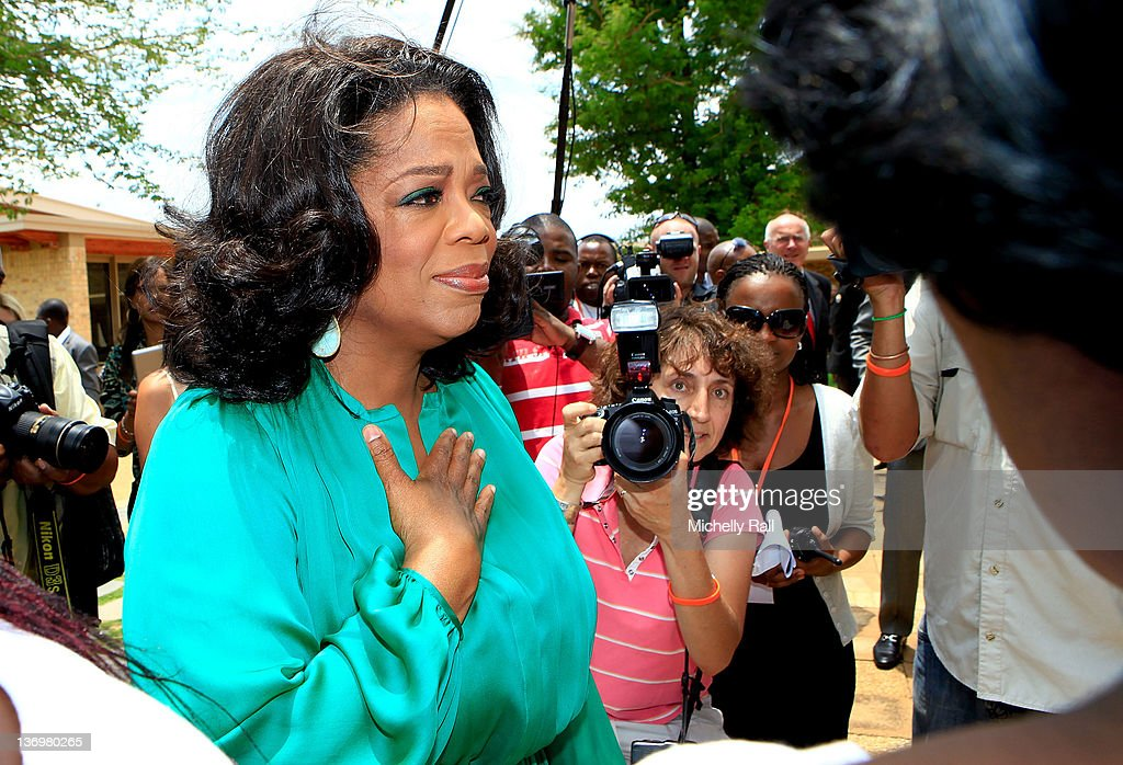 <a gi-track='captionPersonalityLinkClicked' href=/galleries/search?phrase=Oprah+Winfrey&family=editorial&specificpeople=171750 ng-click='$event.stopPropagation()'>Oprah Winfrey</a> greets the Graduates on her arrival at the inaugural graduation of the class of 2011 at <a gi-track='captionPersonalityLinkClicked' href=/galleries/search?phrase=Oprah+Winfrey&family=editorial&specificpeople=171750 ng-click='$event.stopPropagation()'>Oprah Winfrey</a> Leadership Academy for Girls on January 14, 2012 in Henley on Klip, South Africa.