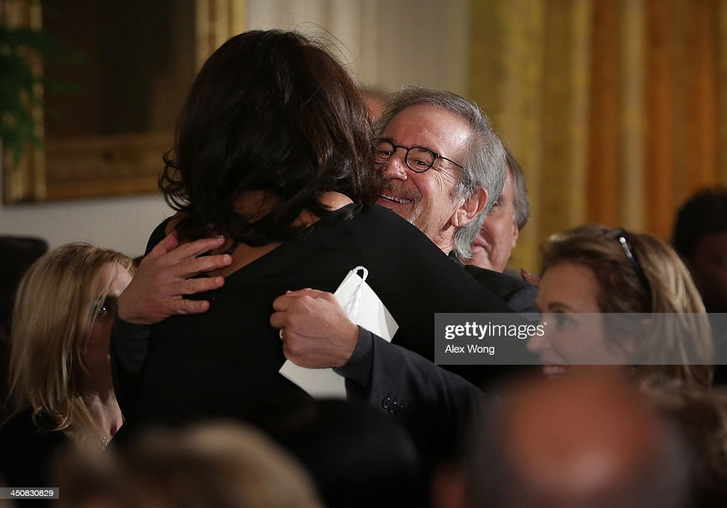 Oprah Winfrey (L) is hugged by film director Steven Spielberg (R) at the end of the Presidential Medal of Freedom presentation ceremony in the East Room at the White House on November 20, 2013 in Washington, DC. The Presidential Medal of Freedom is the nation's highest civilian honor, presented to individuals who have made meritorious contributions to the security or national interests of the United States, to world peace, or to cultural or other significant public or private endeavors.