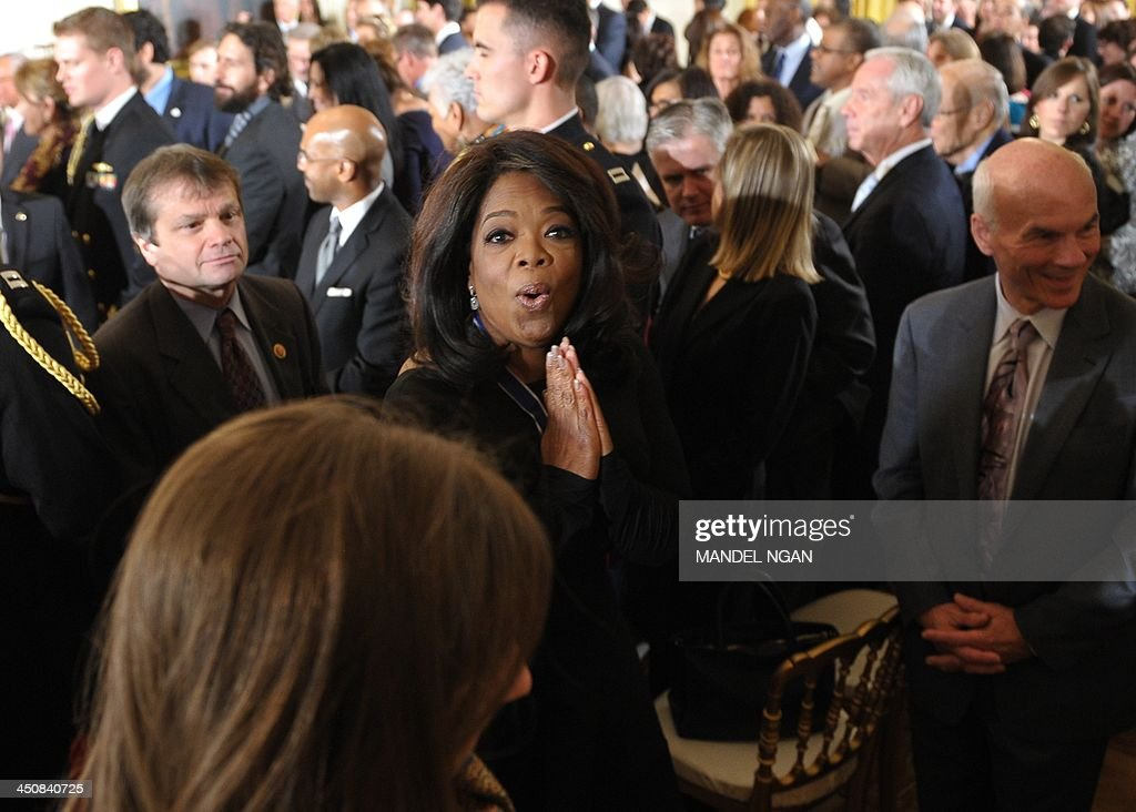 Oprah Winfrey makes her way from the East Room after receiving the Medal of Freedom during a ceremony at the White House on November 20, 2013 in Washington, DC. The Medal of Freedom is the country's highest civilian honor. AFP PHOTO/Mandel NGAN