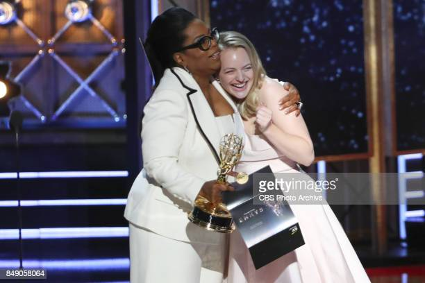 Oprah Winfrey presents Elisabeth Moss the Emmy Award for Outstanding Drama Series at the 69TH PRIMETIME EMMY AWARDS LIVE from the Microsoft Theater...