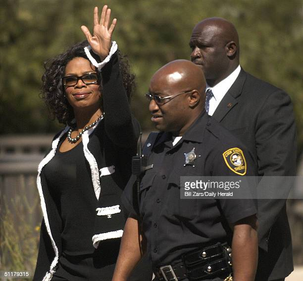 Oprah Winfrey reports for jury duty with an escort of Sheriff's Deputies through a side entrance at the Cook County Criminal Courts Building August...