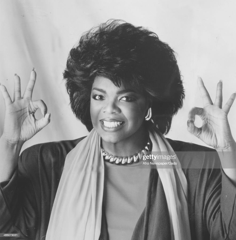 Oprah Winfrey smiles and gives the Okay sign during her time hosting the television show People Are Talking, 1978.