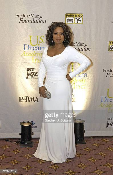 Oprah Winfrey stands for photos before the US Dream Academy's 4th Annual Gala fundraiser on April 24 2005 in Washington DC The Dream Academy supports...