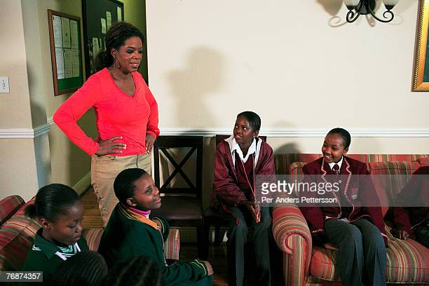 Oprah Winfrey talks to some of the girls that she interviewed for her school for unprivileged girls on August 10 2006 in Johannesburg South Africa...