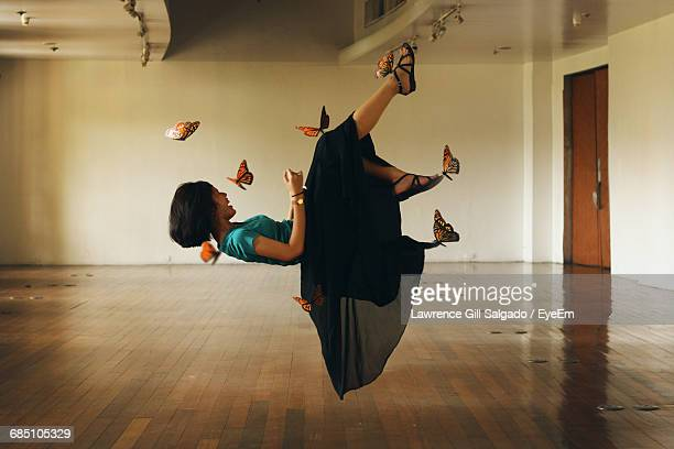 Optical Illusion Of Butterflies Holding Girl In Mid-Air At Room