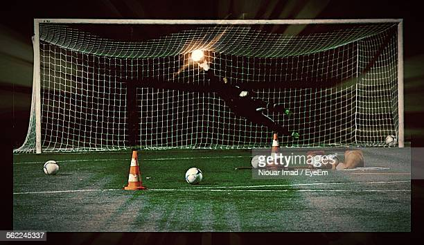 Optical Illusion Of Goalie Saving Illuminated Spotlight