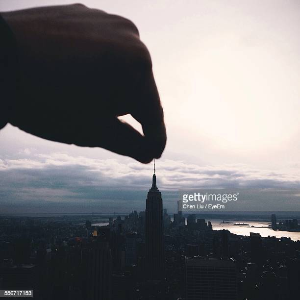 Optical Illusion Of Hand Holding Empire State Building