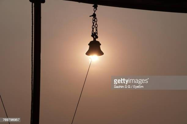 Optical Illusion Of Sun Under Bell