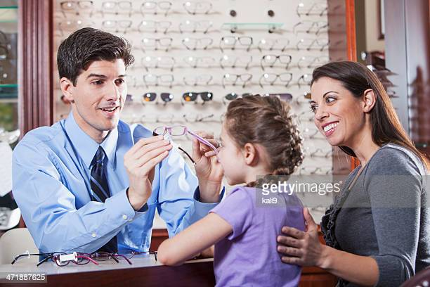 Optician helping a child