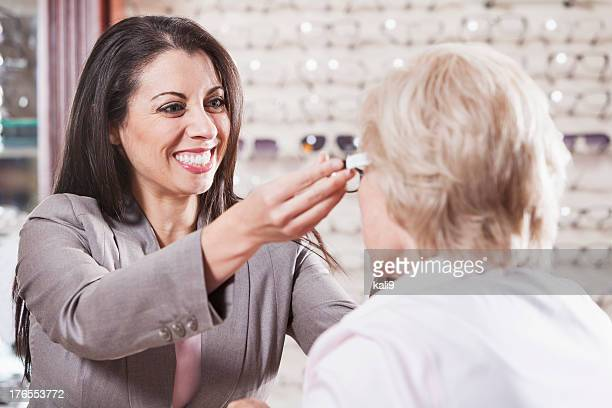 Optician helping a customer