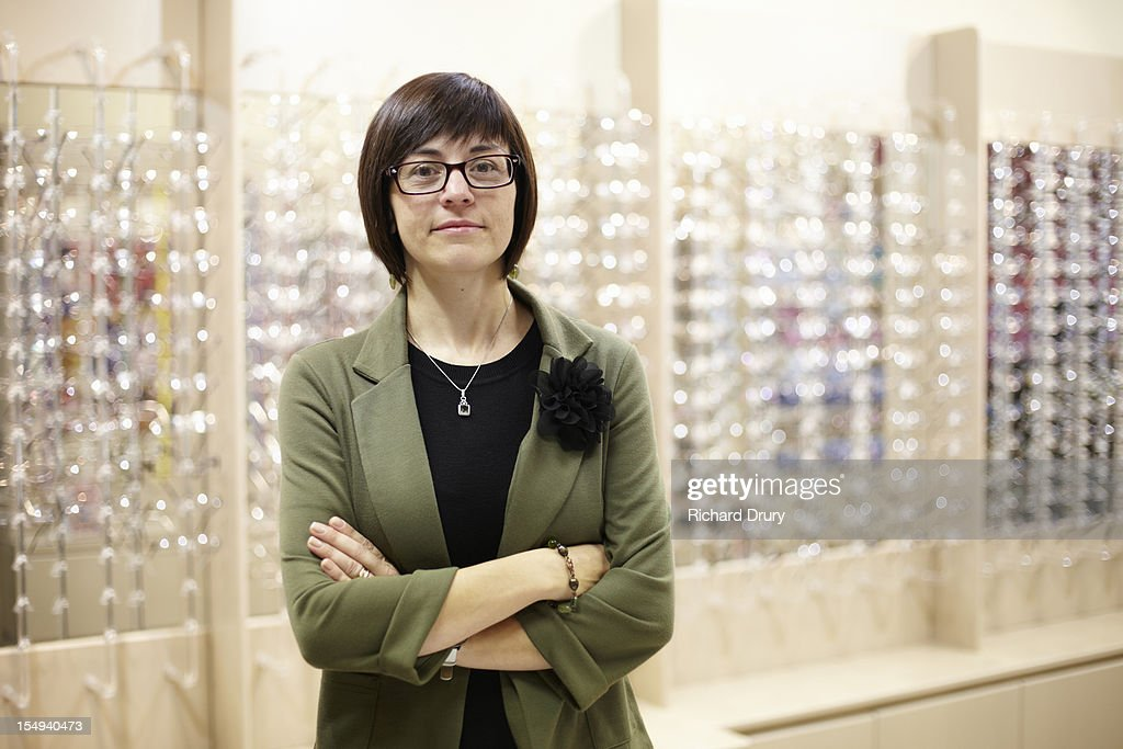 Optician in her shop : Stock Photo