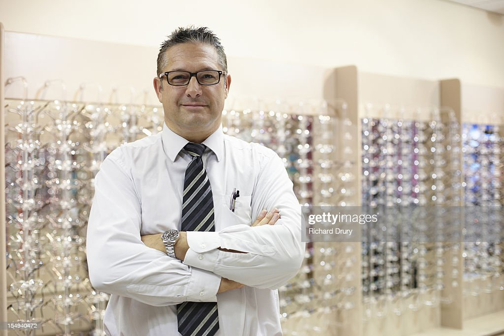 Optician in his shop : Stock Photo