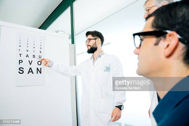 Opticians Making Eye Test To A Patient