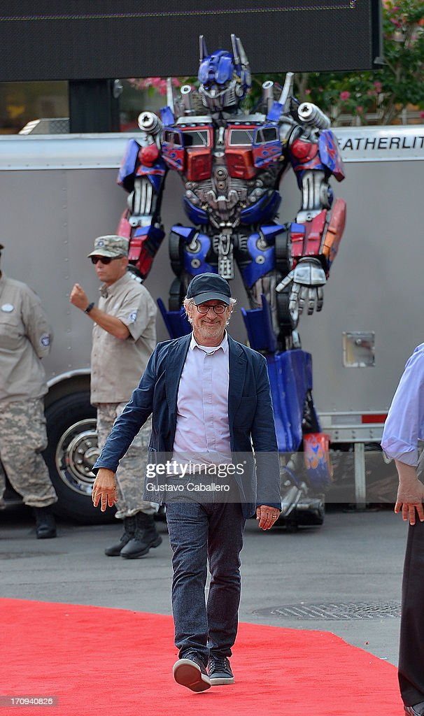 Optimus Prime and Steven Spielberg attend Transformers The Ride - 3D Grand Opening Celebration at Universal Orlando on June 20, 2013 in Orlando, Florida.