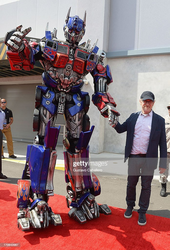 Optimus Prime and <a gi-track='captionPersonalityLinkClicked' href=/galleries/search?phrase=Steven+Spielberg&family=editorial&specificpeople=202022 ng-click='$event.stopPropagation()'>Steven Spielberg</a> attend Transformers The Ride - 3D Grand Opening Celebration at Universal Orlando on June 20, 2013 in Orlando, Florida.