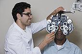 Optometrist examining patient's eyes