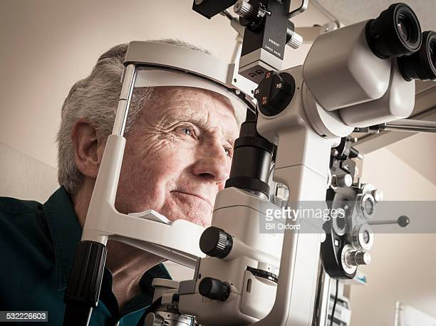 Optometrist with senior patient