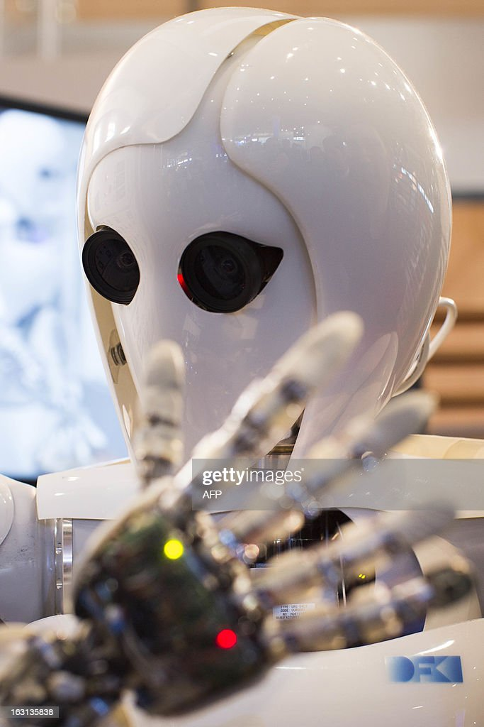 AILA, or Artificial Intelligence Lightweight Android, is pictured during a demonstration at the German Research Center for Artificial Intelligence GmbH (Deutsches Forschungszentrum fuer Kuenstliche Intelligenz GmbH) stand at the 2013 CeBIT technology trade fair on March 5, 2013 in Hanover, Germany. CeBIT will be open March 5-9. AFP PHOTO / CARSTEN KOALL