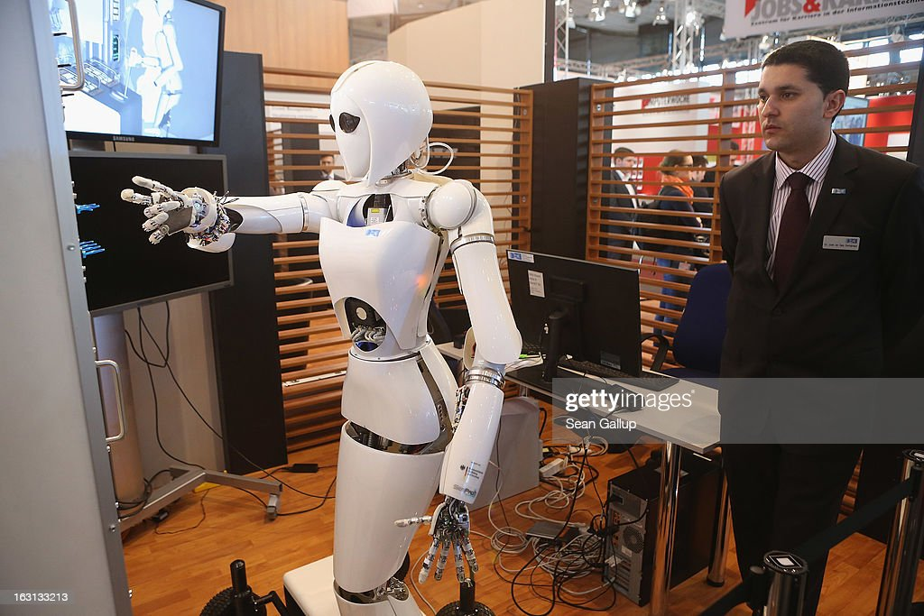 AILA, or Artificial Intelligence Lightweight Android, prepares to press switches on a panel it recognizes during a demonstration at the German Research Center for Artificial Intelligence GmbH (Deutsches Forschungszentrum fuer Kuenstliche Intelligenz GmbH) stand at the 2013 CeBIT technology trade fair on March 5, 2013 in Hanover, Germany. CeBIT will be open March 5-9.