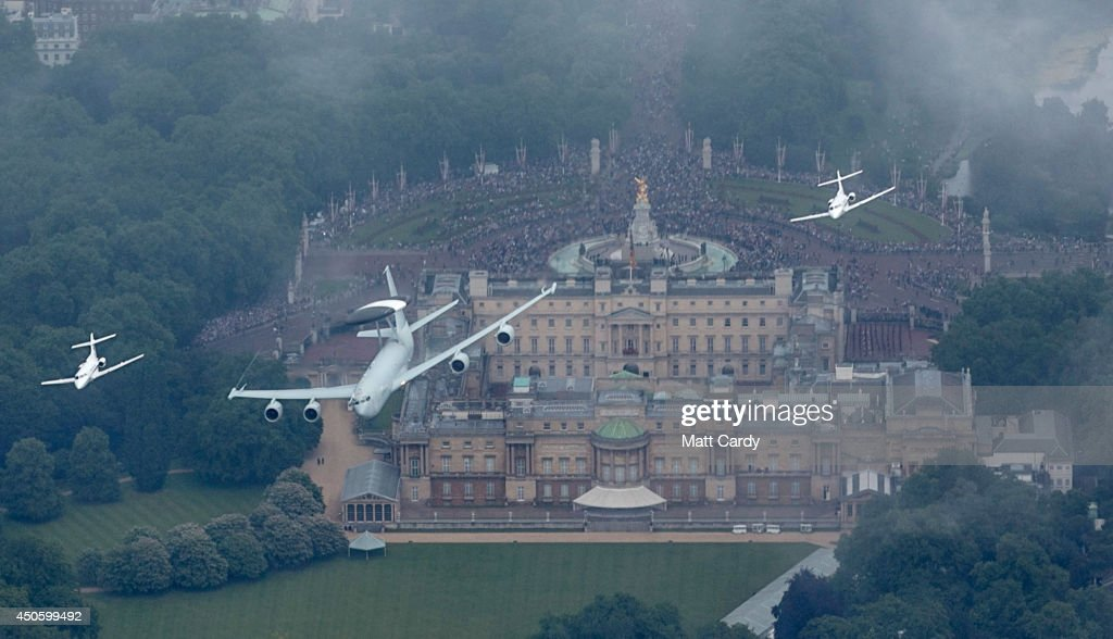 A E-3D or AWACS flanked by two HS 125s fly over Buckingham Palace as part of Her Majesty The Queen's Birthday Flypast during Trooping the Colour on June 14, 2014 in London, England.