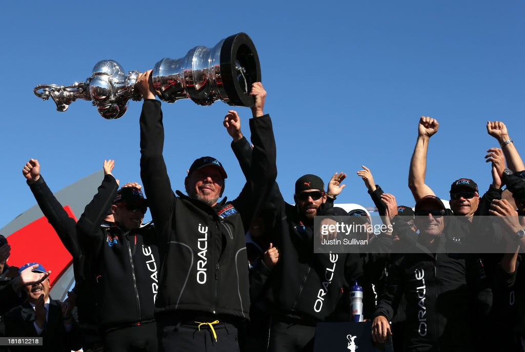 Oracle CEO Larry Ellison and Oracle Team USA celebrates onstage after defending the Cup as they beat Emirates Team New Zealand to defend the America's Cup during the final race on September 25, 2013 in San Francisco, California.
