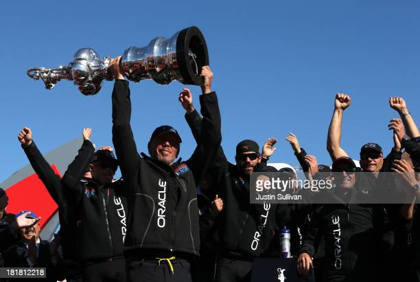 Oracle CEO Larry Ellison and Oracle Team USA celebrates onstage after defending the Cup as they beat Emirates Team New Zealand to defend the...