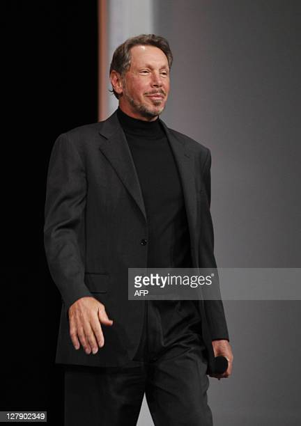 Oracle CEO Larry Ellison appears to the stage to receive the 2010 World Series ring from the San Francisco Giants President Larry Baer at the Moscone...